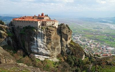 After breakfast, travel to Meteora located in Thessaly plains, massive gray colored rocks rise towards the sky and monasteries perched on top of enormous rocks.