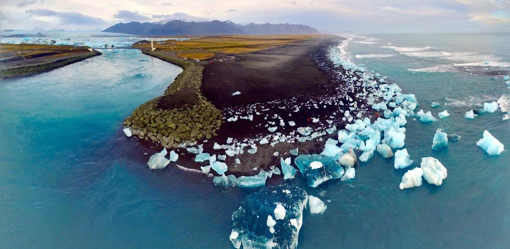 After attempting to internalize the beauty of blue ice, transfer to Jokullsarlon where you ll be taken further
