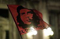 "Dr. Peter McLaren, author of Che Guevara, Paulo Freire, and the Pedagogy of Revolution [173] A stylized graphic of Guevara's face on a flag above the words ""El Che Vive"" (The Che Lives)."