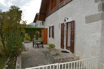 a hamlet, on the ground floor of our chalet, household linen, large terrace, garden, barbecue, car shelter.