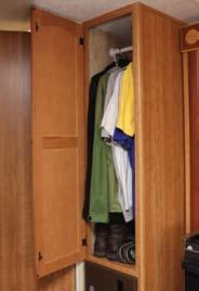 Shown Below: The adjustable shelving pantry doubles as a wardrobe. Perfect for the trips when you need to bring those extra clothes or larger items.
