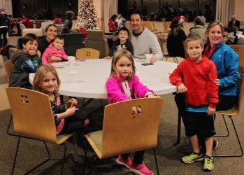 The atmosphere inside the community center was warm and festive as staff members served cookies and hot cocoa.