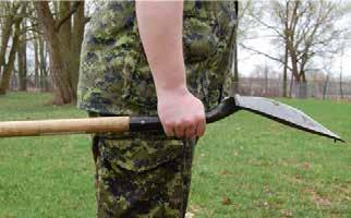 It can be carried in hand, with the blade facing down. Shovel Figure 2 Bow Saw Note. Created by Director Cadets 3, 2009 Ottawa, ON: Department of National Defence.