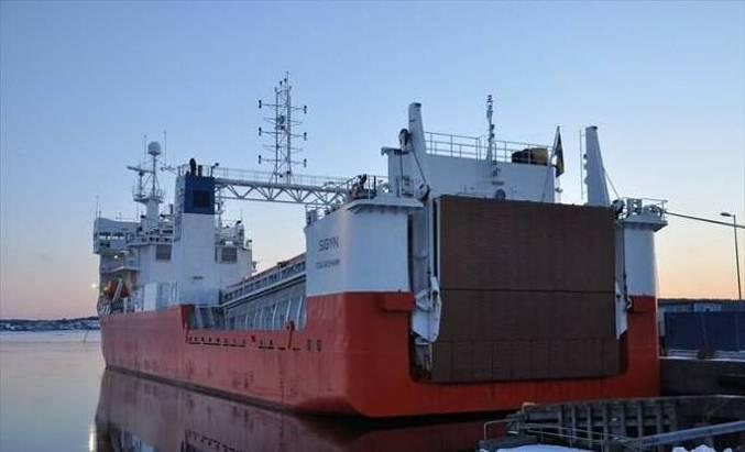 European Venture, a car carrier full of Toyotas, was berthing on the wharf opposite in the large basin.