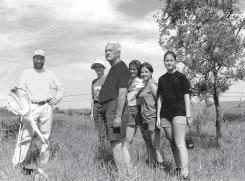 Photo by Laura Whitney Land donor Howard Juhl (center), 1996.