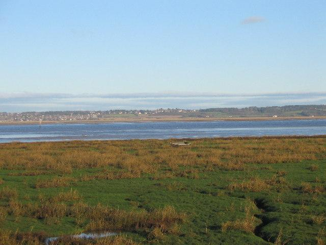 The Dee Estuary from Flintshire From the M56, the village is off the A55 North Wales Expressway between Queensferry and Colwyn Bay.