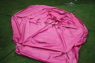 trampoline tent roof. Firstly lay out the fibreglass rods as shown to the left.