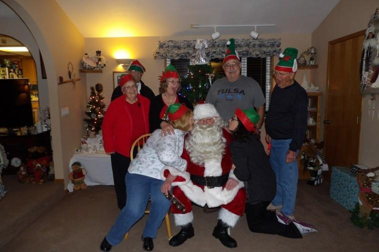 Dinner was wonderful; Taco soup, a beautiful salad, a veggie tray and Apple Dump Cake for dessert. On December 19 th we again met at the Martins home along with Santa and his wife Eileen aka Mrs.