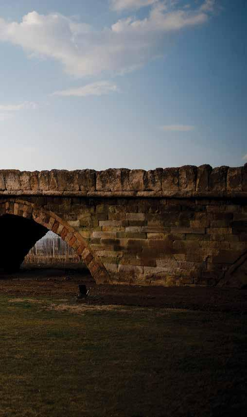 STORIES OLD AND NEW OF A COUNTRY THRIVING The Old Stone Bridge with nine arches is