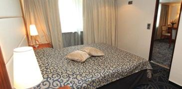 unobstructed view; queen bed, private bath with full tub, refrigerator approx. 310 sq. ft.
