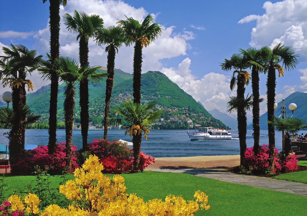 Lake Lugano offers a taste of Italy in Switzerland. Pass through the Alps.